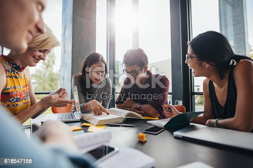 istock University students doing group study in library 618547158