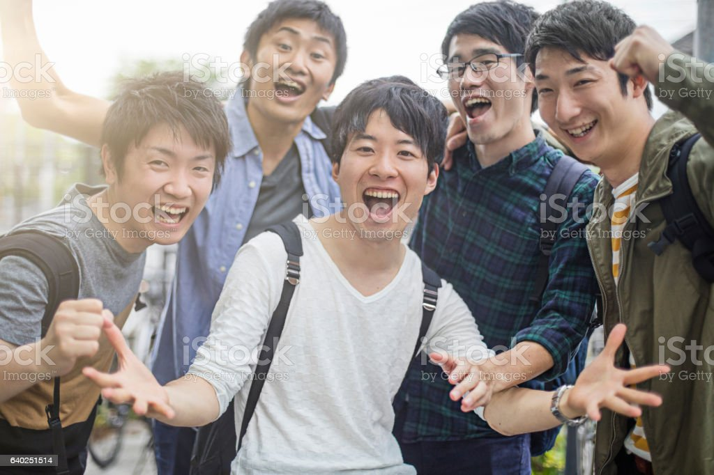University students gesturing while screaming ストックフォト