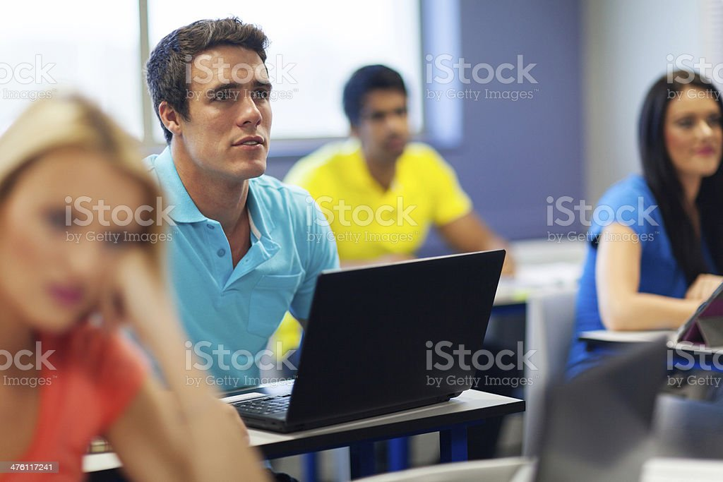 university students in lecture hall stock photo
