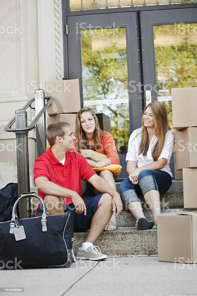 University Students Moving into the Campus Dormitory royalty-free stock photo
