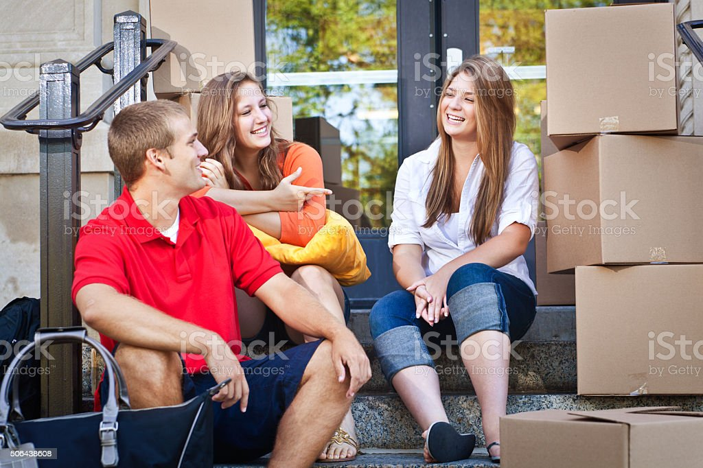 University Students Moving into the Campus Dormitory stock photo