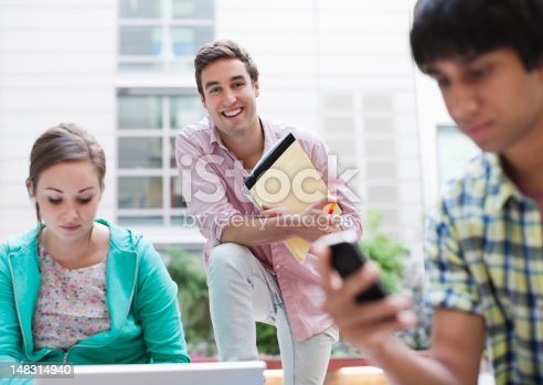 143071438istockphoto University students outdoors 148314940