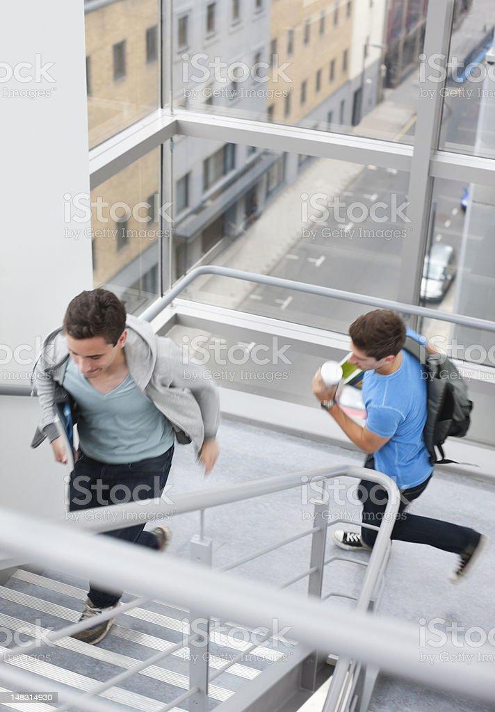University students rushing up stairs royalty-free stock photo