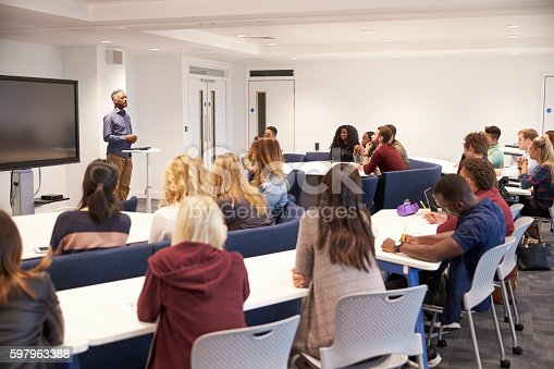 istock University students study in a classroom with male lecturer 597963388