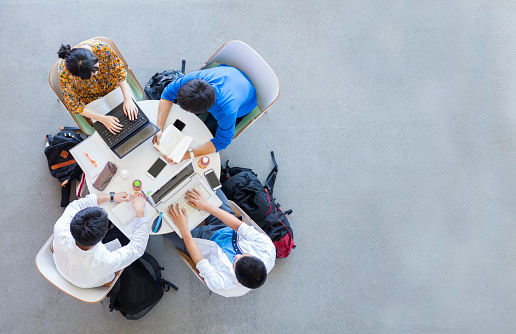 istock University Students Studying In A Group 694725410