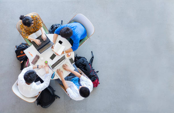 University Students Studying In A Group stock photo