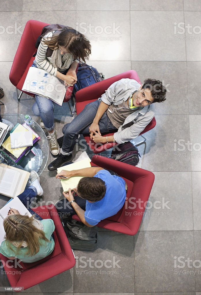 University students studying in armchairs royalty-free stock photo
