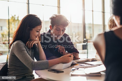 istock University students studying together in class. 623349770
