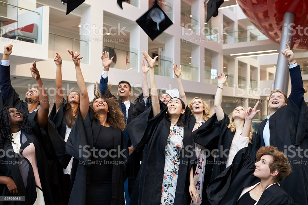 University students throwing their caps in the air - Royalty-free 20-29 Years Stock Photo