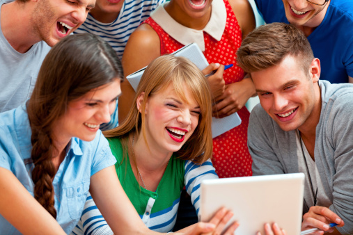 University Students Using A Digital Tablet Stock Photo - Download Image Now