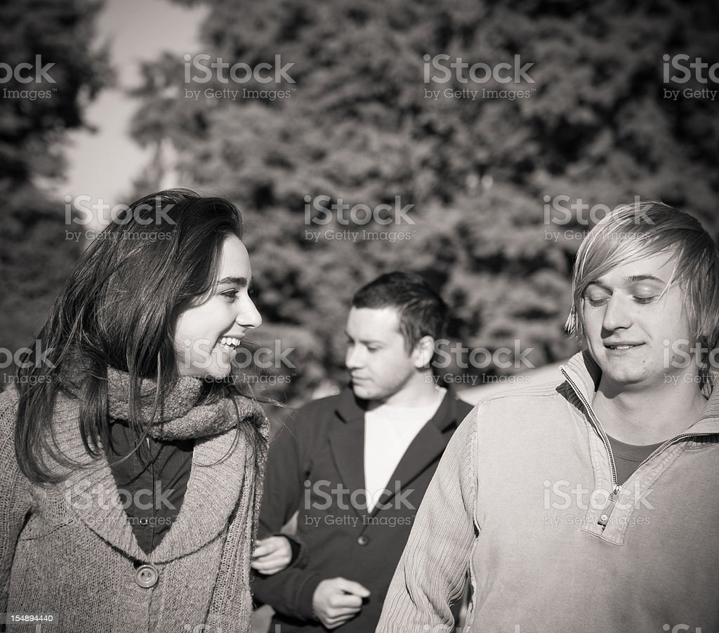 University students walking and speaking outdoors royalty-free stock photo
