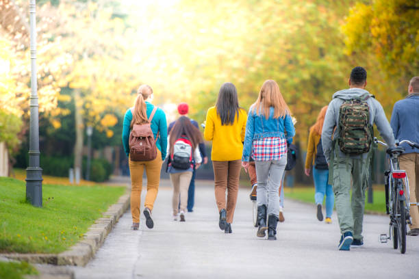 University students walking in campus stock photo