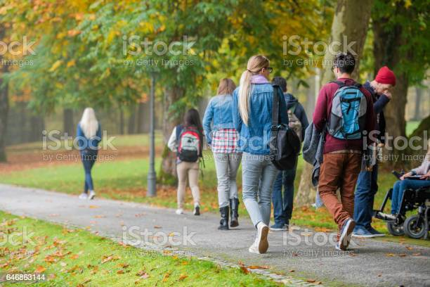 University students walking in campus picture id646863144?b=1&k=6&m=646863144&s=612x612&h=4ppmt fy9u8neupg oqorh1d c33ewi9kvhgzscjuta=