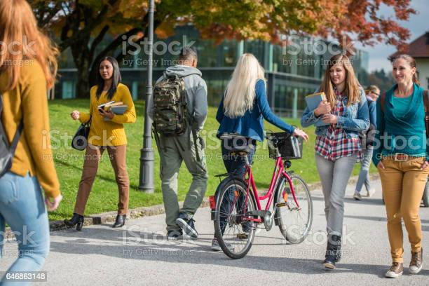 University students walking in campus picture id646863148?b=1&k=6&m=646863148&s=612x612&h=zylvewwwr247qii 6mfp8acqslwp6ysohojuylwvj2w=
