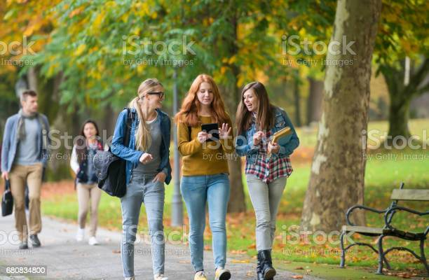 University students walking in campus picture id680834800?b=1&k=6&m=680834800&s=612x612&h=eq78p4b9gc tqfm76ybk0qvxout9dx9cjkxr2xigesc=