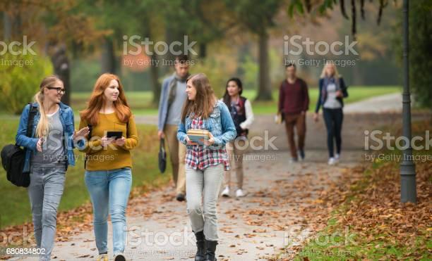 University students walking in campus picture id680834802?b=1&k=6&m=680834802&s=612x612&h=ejlp9eal0thjhyddtscey2qyegbcsa8ijfk3708brkc=