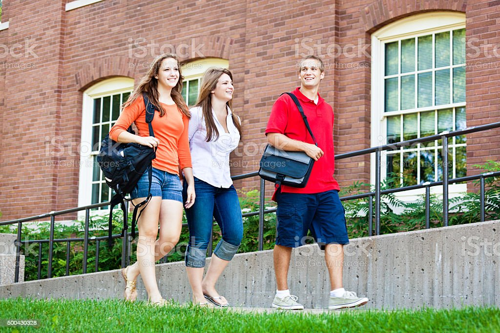 University Students Walking on College Campus Dorm Hall stock photo