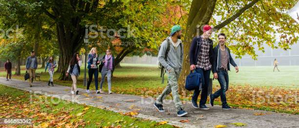 University students walking on footpath picture id646863042?b=1&k=6&m=646863042&s=612x612&h=t9u4alrmzisnmztisvpxhpgukmbbm6lz7thkfguydvk=