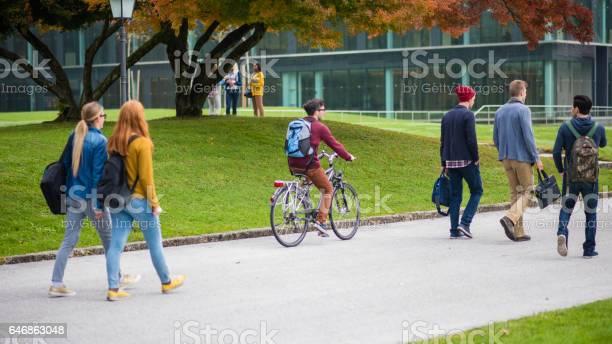 University students walking on footpath picture id646863048?b=1&k=6&m=646863048&s=612x612&h=j0rupvc2vf7tx7wv0kyublrhrzjpa6pqgu5yjlpmecc=