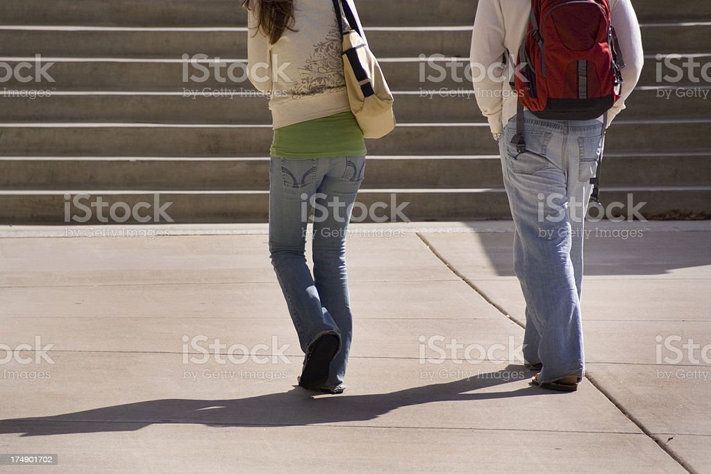 University Students Walking, Taking Steps for College Campus Higher Education royalty-free stock photo