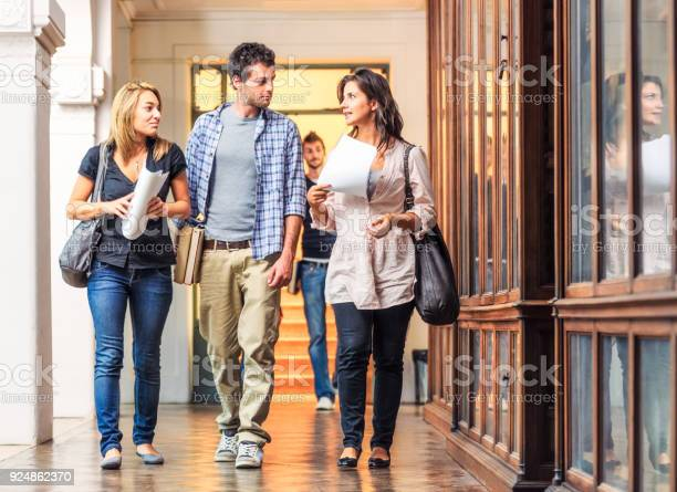 University students walking together through library corridor picture id924862370?b=1&k=6&m=924862370&s=612x612&h=tbqubhvzajr1rmmpzqgkjmtvlv5ofjledunqpemqmn0=