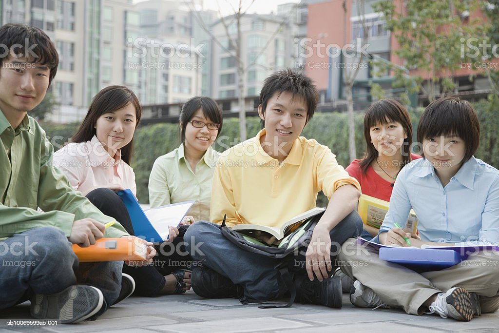 University students with sitting with holding book, smiling, portrait foto stock royalty-free