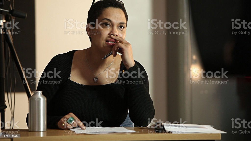 University tutor listening to student presentation royalty-free stock photo
