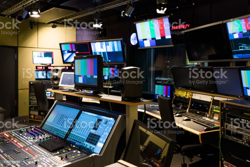 A university tv studio with various screens and consoles.