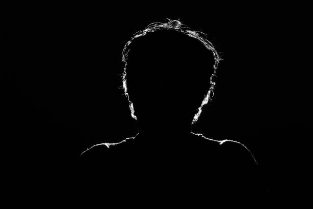 Unknown male person silhouette on black background stock photo