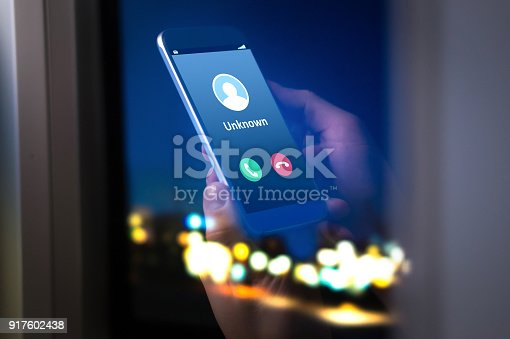 istock Unknown number calling in the middle of the night. Phone call from stranger. 917602438