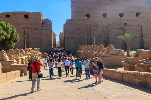 Luxor, Egypt - December 11, 2018: Unknown people at entrance to ancient Karnak Temple Complex in Luxor, Egypt