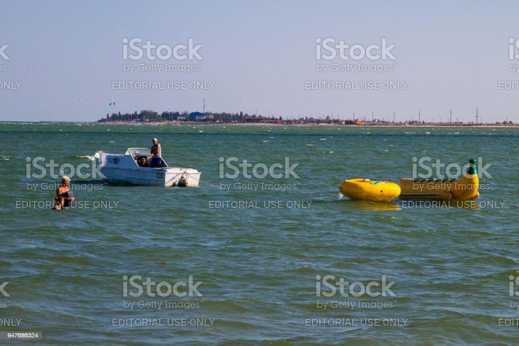 Unknown people having fun in Azov sea stock photo