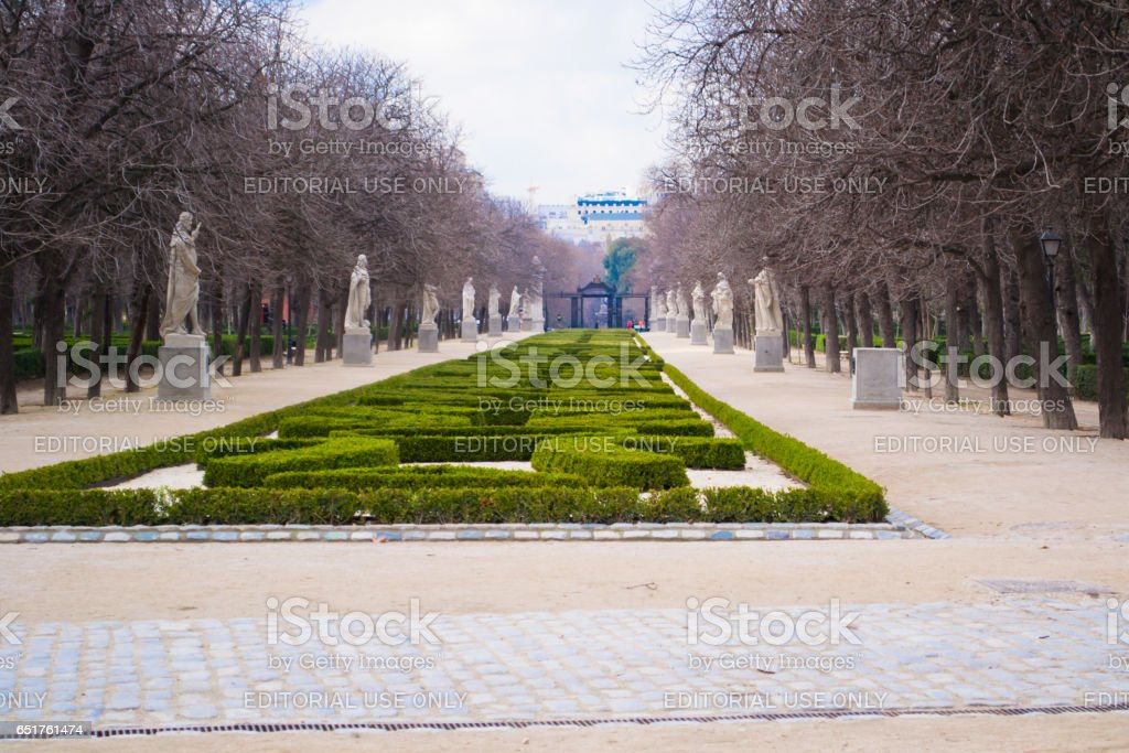 MADRID, SPAIN - FEBRUARY 20, 2013:    Unknown people in the park. Retiro park the city park in the center of Madrid, the popular place of Sunday rest. Madrid capital and the largest city of Spain. stock photo