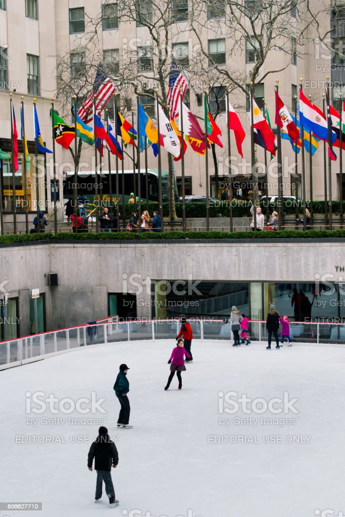 Unknown people on a skating rink. stock photo