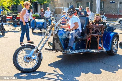 Kremenchug, Ukraine - September 22, 2018: Unknown people rides three wheeled motorcycle on a city square during day of city Kremenchug celebration