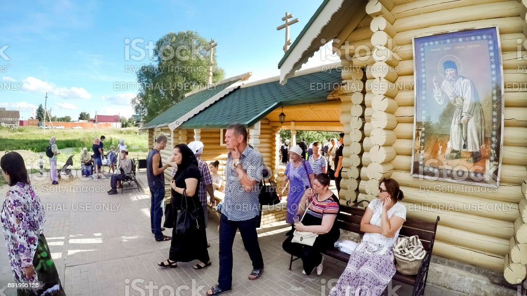 Unknown pilgrims are located near Holy spring in honor of the icon of the Mother of God 'Tenderness' in the village of Diveevo, Russia stock photo