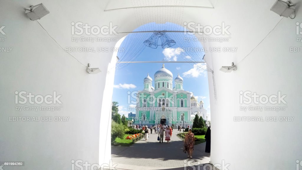 Unknown pilgrims go to morning Divine Liturgy at Trinity Cathedral of Holy Trinity Seraphim-Diveevo nunnery in village Diveevo, Nizhny Novgorod region, Russia stock photo