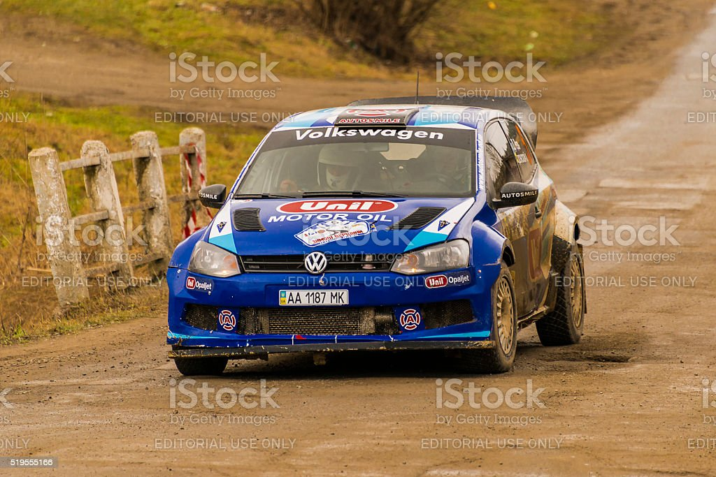 Unknown racer  on the car brand Volkswagen Polo stock photo