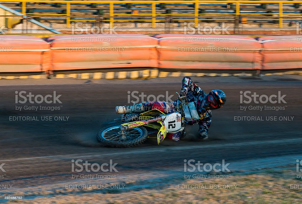 Unknown rider falls at overcoming the track stock photo