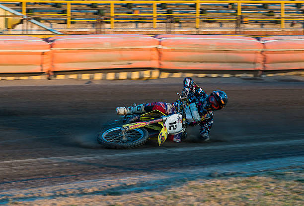 Unknown rider falls at overcoming the track  Rivne, Ukraine - 29 August 2015: Unknown rider falls at overcoming the track at the Open Cup Speedway to the day of the city Rivne kawasaki heavy industries stock pictures, royalty-free photos & images