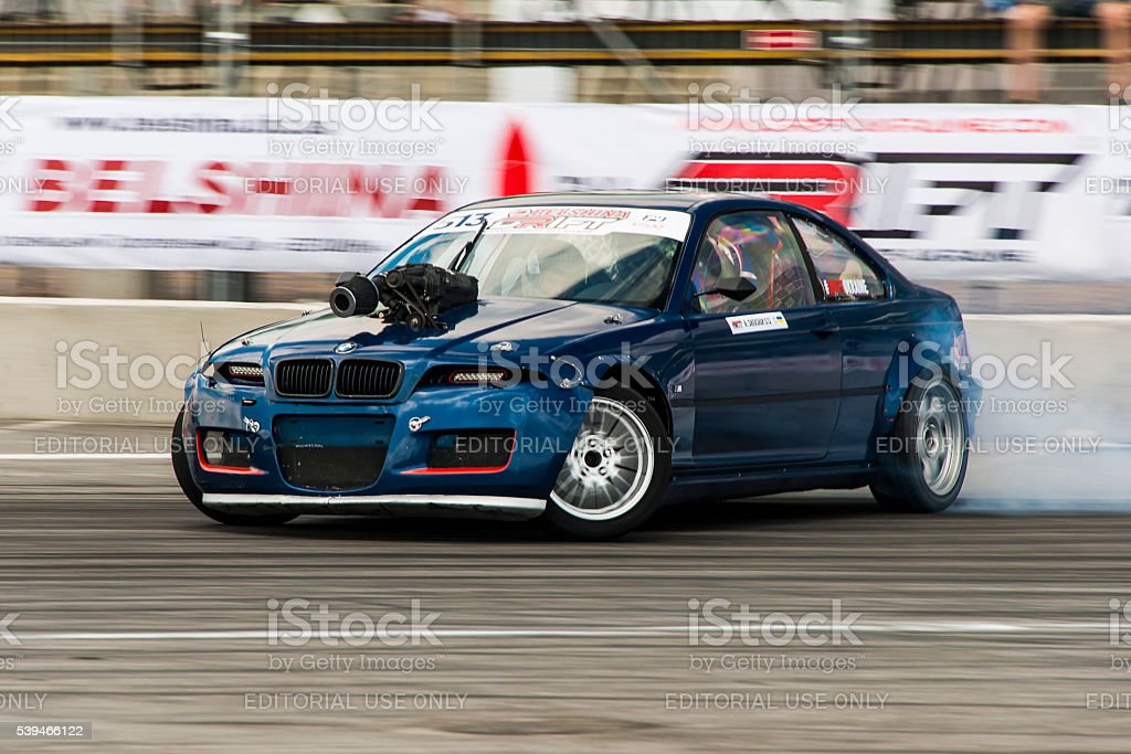 Unknown rider on the car brand BMW overcomes the track in the...