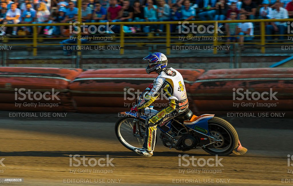 Unknown rider overcomes the track at the Open Cup Speedway to the day...
