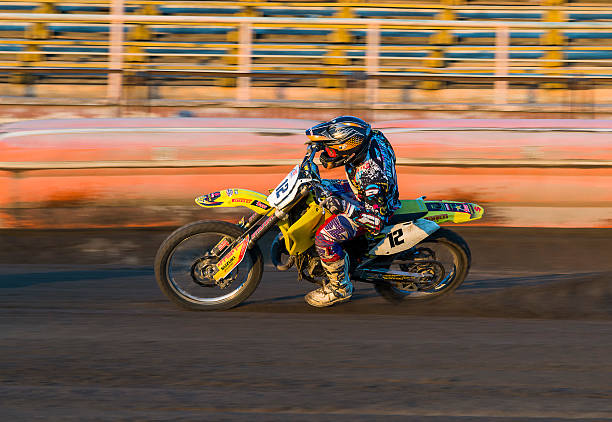 Unknown rider overcomes the track  Rivne, Ukraine - 29 August 2015: Unknown rider overcomes the track at the Open Cup Speedway to the day of the city Rivne kawasaki heavy industries stock pictures, royalty-free photos & images