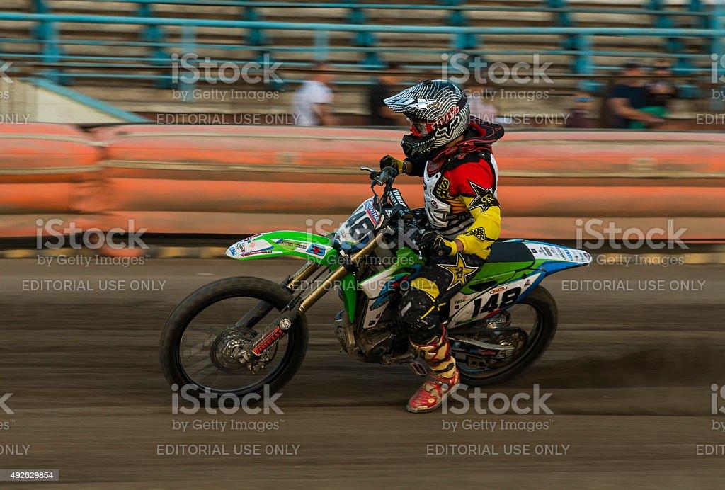 Unknown rider overcomes the track stock photo