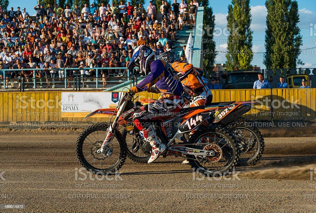 Unknown riders  overcomes the track stock photo