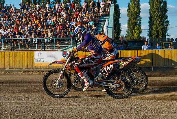Unknown riders  overcomes the track Rivne, Ukraine - 29 August 2015: Unknown riders overcomes the track at the Open Cup Speedway to the day of the city Rivne kawasaki heavy industries stock pictures, royalty-free photos & images