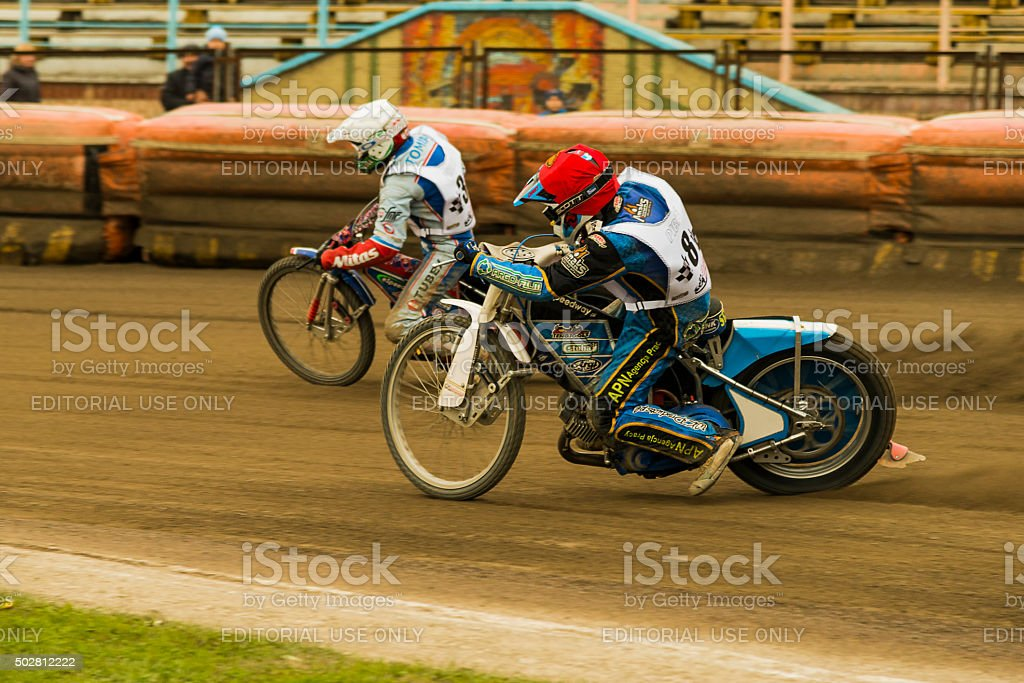 Unknown riders overcomes the track stock photo