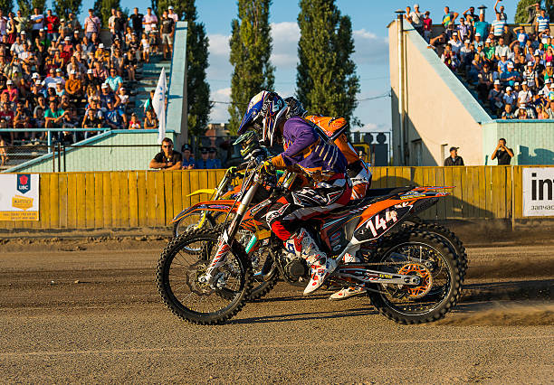 Unknown riders prepares for the start Rivne, Ukraine - 29 August 2015: Unknown riders prepares for the start at the Open Cup Speedway to the day of the city Rivne kawasaki heavy industries stock pictures, royalty-free photos & images