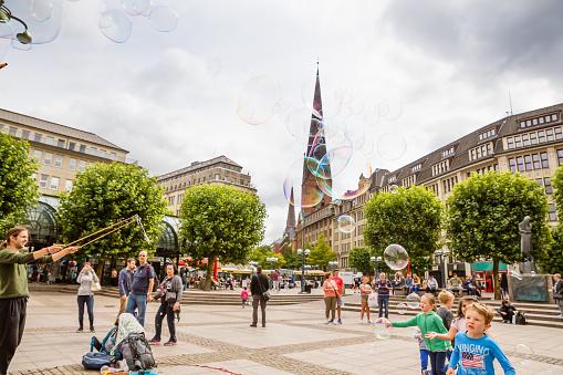 Unknown street artists make big soap bubbles in Hamburg