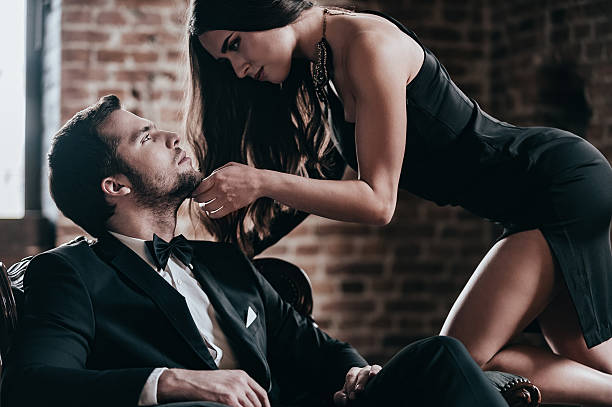 unleashed desire. - man dominating woman stock photos and pictures